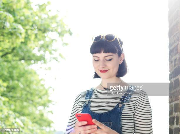 One young woman only texting outdoors