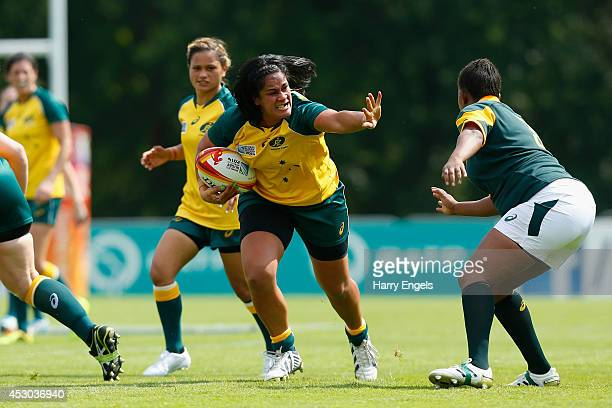 Oneata Schwalger of Australia charges upfield during the IRB Women's Rugby World Cup Pool C match between Australia and South Africa at the French...
