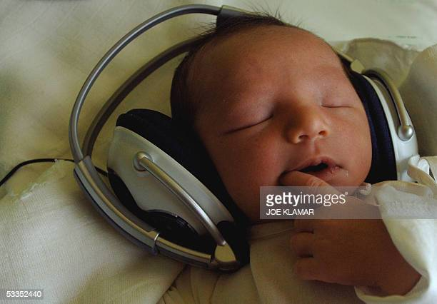 Onedayold newborn baby Timea listens to music with headphones at the 1st Private Hospital in eastern Slovak metropol of KosiceSaca 11 August 2005 The...