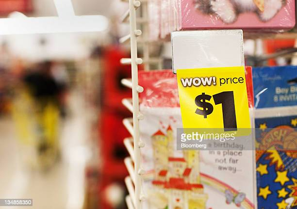 A onedollar price tag appears on a greeting card at a Dollar General Corp store in Saddle Brook New Jersey US on Saturday Dec 3 2011 Dollar General...