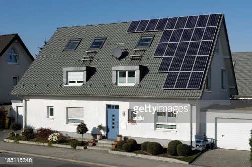 Onefamily houses with solar panels on the roof stock photo getty images - Houses attic families children ...