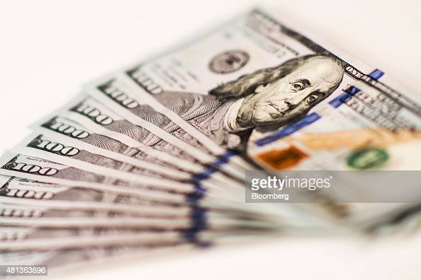 US onehundred dollar bills are arranged for a photograph in Hong Kong China on Monday July 20 2015 The yuan has proven to be among the more resilient...