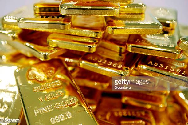 Onekilogram bars of gold are arranged for a photograph at the YLG Bullion International Co headquarters in Bangkok Thailand on Thursday Aug 8 2013...