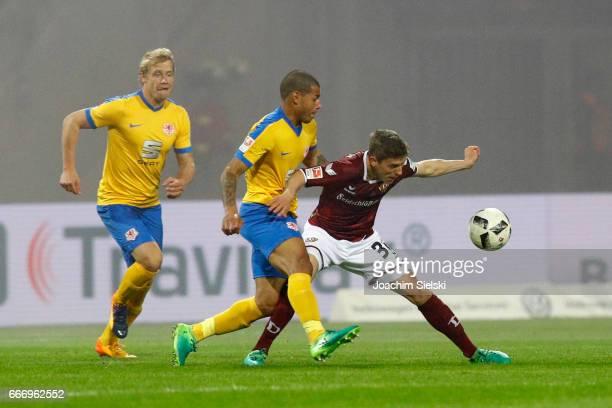 Onel Hernandez of Braunschweig challenges Niklas Hauptmann of Dresden during the Second Bundesliga match between Eintracht Braunschweig and SG Dynamo...
