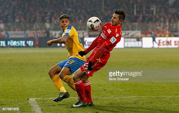 Onel Hernandez of Eintracht Brauschweig battles for the ball with Steven Skrzybski of Union Berlin during the Second Bundesliga match between 1 FC...