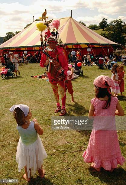 A onemanband entertains two young girls during the third day of the Big Chill music festival at Eastnor Castle Deer Park in the Malvern Hills on...