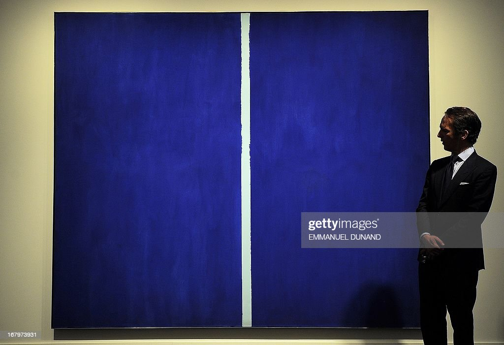 'Onement VI' by Barnett Newman is on display during a preview of Sotheby's Impressionist and Modern Art sales in New York on May 3, 2013. Sotheby's is scheduled to hold its Impressionist & Modern Art sales May 7. AFP PHOTO/Emmanuel Dunand ++RESTRICTED TO EDITORIAL USE, MANDATORY MENTION OF THE ARTIST UPON PUBLICATION, TO ILLUSTRATE THE EVENT AS SPECIFIED IN THE CAPTION++