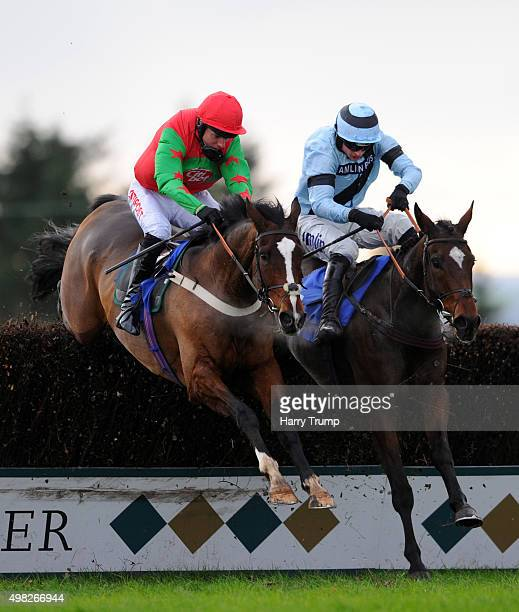 OnenightinVienna ridden by Tom O'Brien jumps the last ahead of Fletchers Flyer to win the Higos Insurance Services Novices Chase at Exeter Racecourse...