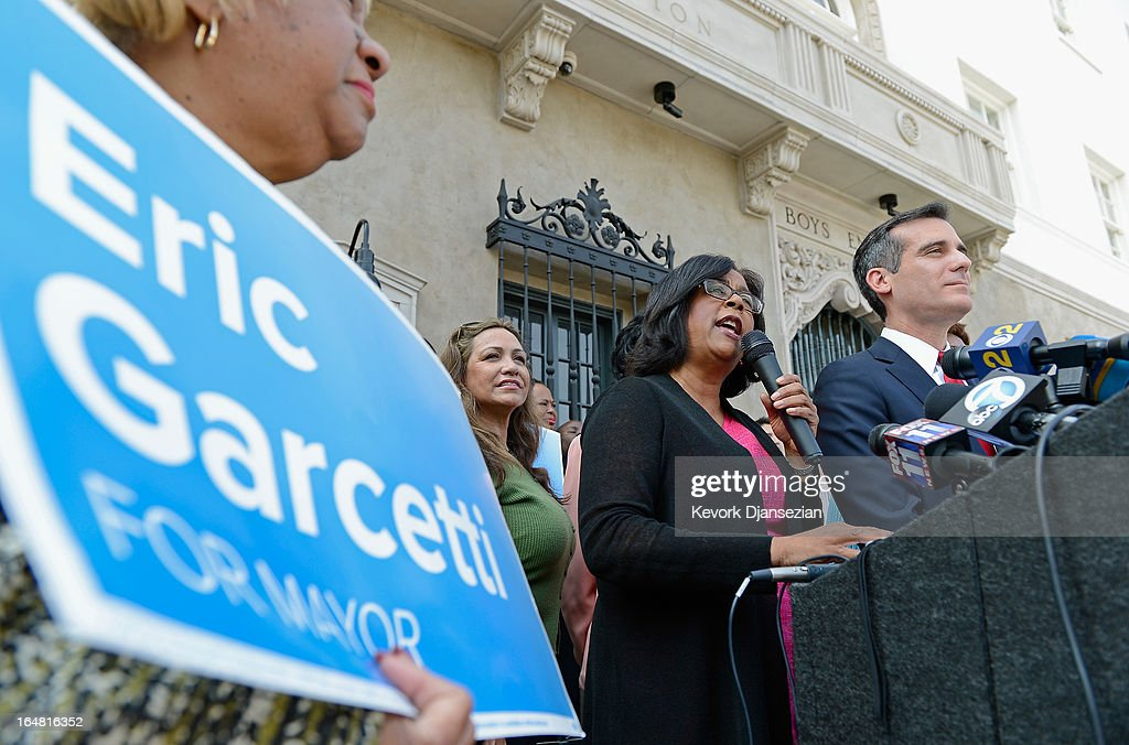One-time mayoral candidate Councilwoman Jan Perry (2R) speaks after endorsing mayoral candidate Councilman <a gi-track='captionPersonalityLinkClicked' href=/galleries/search?phrase=Eric+Garcetti&family=editorial&specificpeople=635706 ng-click='$event.stopPropagation()'>Eric Garcetti</a> (R) in the Los Angeles mayoral race, on the front steps of the YMCA on March 28, 2013 in Los Angeles, California. Garcetti is in a tight race for the May 21 runoff against second-place finisher City Controller Wendy Greuel.