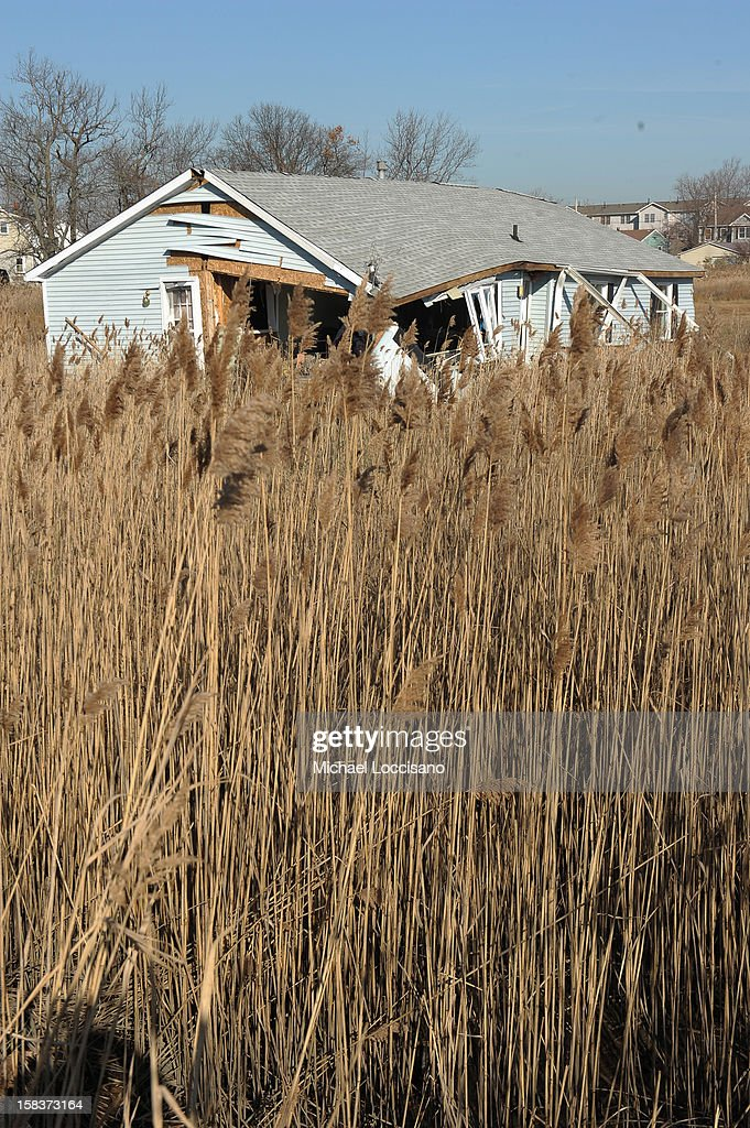 A onetime residence by a field is now a vacant lot of wreckage on December 14, 2012 in Union Beach, New Jersey. The town is struggling to rebuild and recover from the devastation left by Superstorm Sandy and relying heavily on donations.