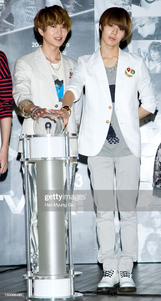 Onew and Taemin of South Korean boy band SHINee attend during the 'S.M.ART Exhibition' opening ceremony held at Coex on August 09, 2012 in Seoul, South Korea.