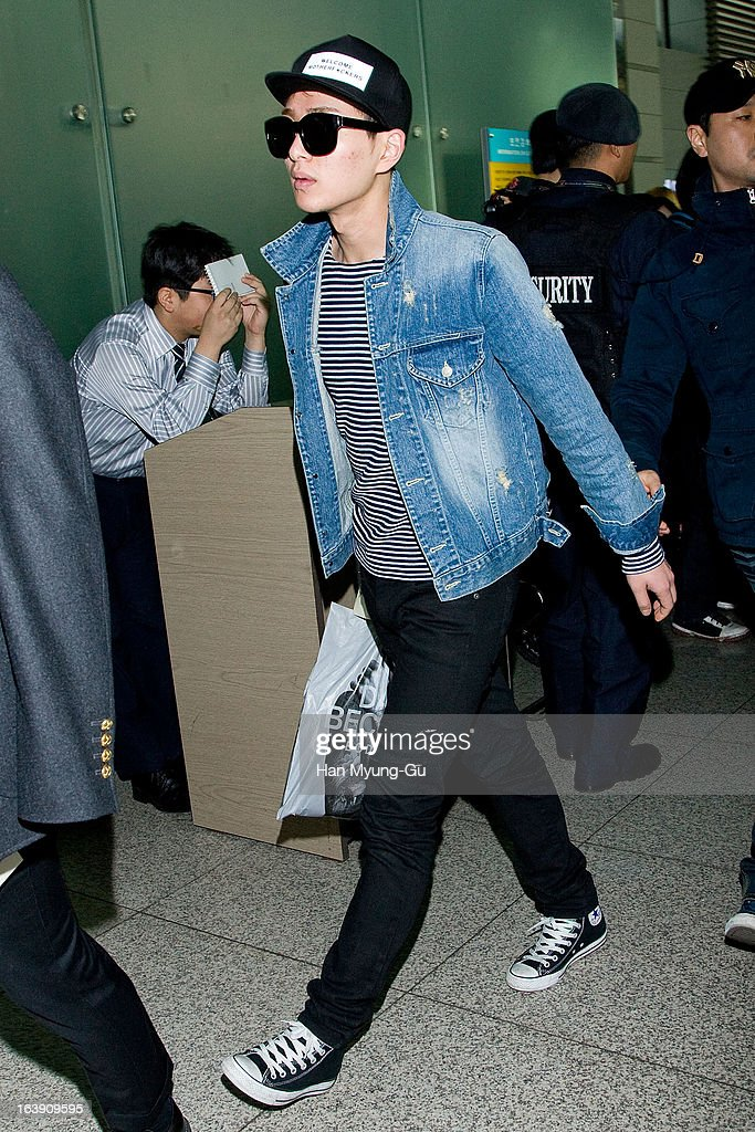 Onew of South Korean boy band SHINee is seen on departure at Incheon International Airport on March 15, 2013 in Incheon, South Korea.