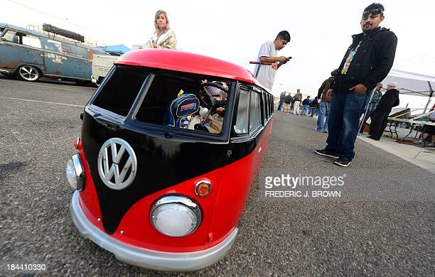 Oneyear old Xavier peers out from his miniature Volkswagen bus made by his dad at 'Das OCTO Fest 2013' a swap and display gathering for enthusiasts...