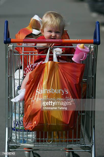 Oneyearold Beatrice Halpin rides in a shopping trolley next to her mothers new Sainsbury's 'Bag for Life' on April 27 2007 in Northwich Cheshire...