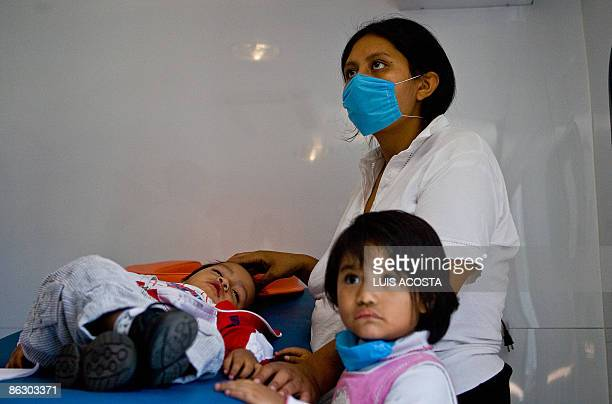 Oneyearold child Ulises Gabriel Sanchez lies on a stretcher accompanied by his mother Violeta Perez and sister Paola Sanchez waiting for the result...