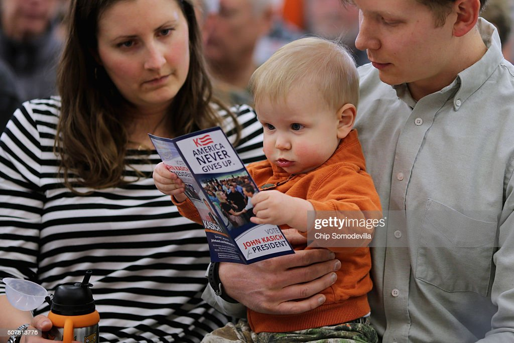 Oneyearold Lou Almstrom and his parents Scott and Katy Almstrom of Lebanon wait for the start of a town hall meeting with Republican presidential...