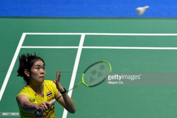 Ongbamrungphan Busanan of Thailand plays a return shot to her compatriot Ratchanok Intanon in the women's singles during round two of the 2017 World...