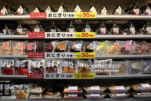 Onigiri rice balls and bento lunch boxs sit on the shelf at a newly designed trainshaped convenience store named Lawson Friends on its opening day at...