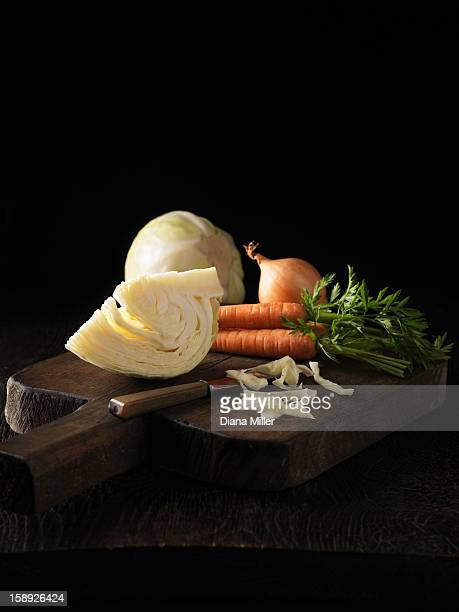 Onion, carrot and cabbage on board