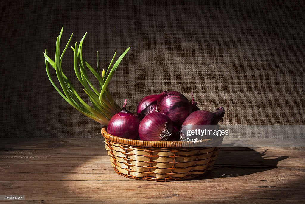 Onions in a wicker basket : Stock Photo