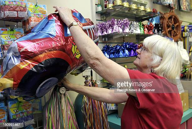 Onita Gibbs fills a helium balloon for a customer at The Party Shop in Cameron Village in Raleigh North Carolina on August 23 2012 For the past few...