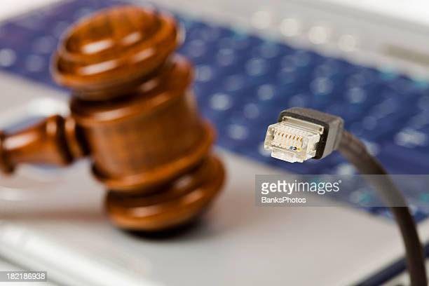 Online Auction Concept with Ethernet Cable, Gavel and Laptop