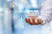 Online course in hand businessman on blurred background.