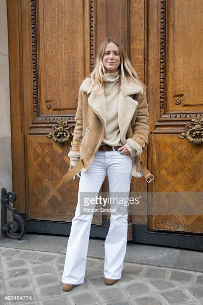 Online Editor for French Vogue Jennifer Neyt wears an ACNE coat and Isabel Marant jumper jeans and shoes on day 4 of Paris Haute Couture Fashion Week...
