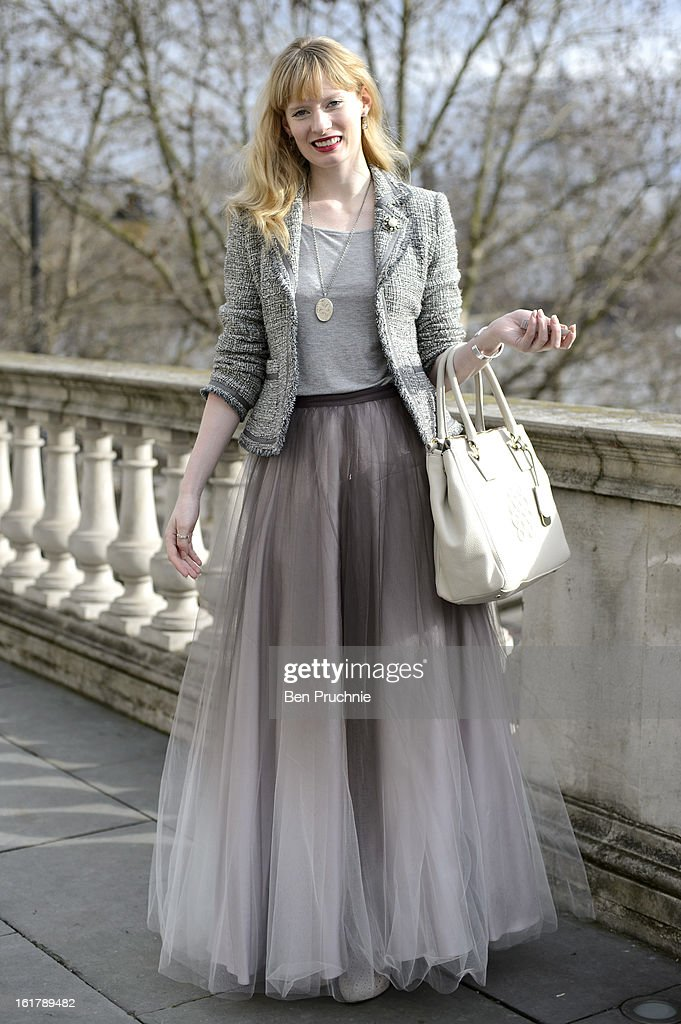 Online editor Lizzy poses wearing a Coast skirt, vintage jacket necklace and accessories with Gucci and a Bailey and Quinn bag at Somerset House during London Fashion Week F/W 2013 on February 16, 2013 in London, England.