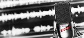 online radio studio. condenser microphone close up. Digital recording, editing, broadcasting or podcasting concept.