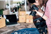 Online seller owner take a photo of product for upload to website online shop. Online Shop, Online Selling , Online Shopping and e-Commerce concept.