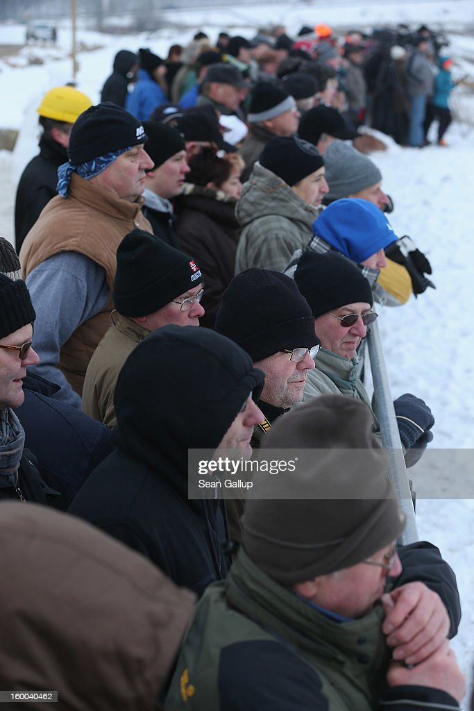 Onlookers brave sub-zero temperatures to watch workers attempt to set a 950-tonne bucket excavator upright following an accident at an open-pit coal mine on January 25, 2013 near Deutzen, Germany. The bucket excavator tipped over last summer after plateaus of earth and sand nearby gave way, pushing a layer of coal underneath. The excavator has been lying severaly tilted to one side ever since at the Vereinigtes Schleenhain mine, which is operated by Mibrag. Open-pit lignite coal mines are still common across eastern Germany and produce coal for local electricity production.