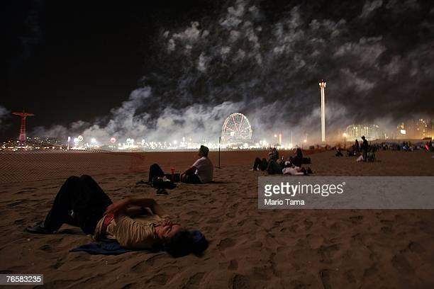 Onlookers gather as smoke fills the air during the last fireworks show of the summer at Coney Island September 7 2007 in the Brooklyn borough of New...