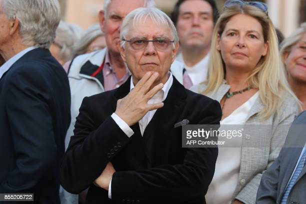 Onlookers including Italian artist Milo Manara gather beside a statue of French actress Brigitte Bardot during its inauguration in SaintTropez on...