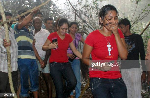 Onlookers react at the crash site of an Air India Boeing 737800 aircraft in Mangalore on May 22 2010 An Air India Express passenger plane crashed in...