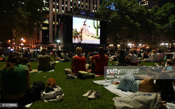 Onlookers view a preview scene during an outdoor screening at the HBO Bryant Park Summer Film Festival July 6 2004 in New York City The festival...