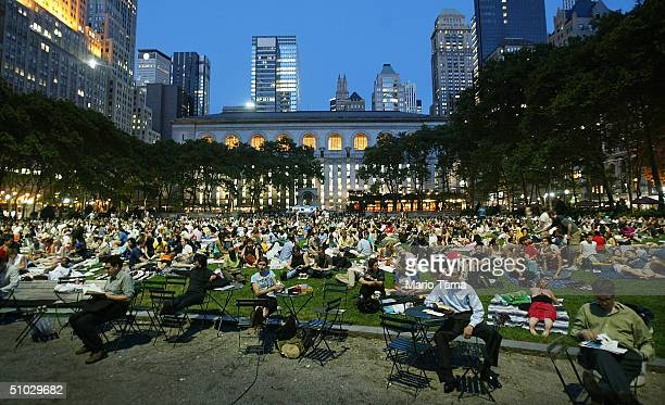 Onlookers wait for an outdoor screening to begin at the HBO Bryant Park Summer Film Festival July 6 2004 in New York City The festival shows classic...