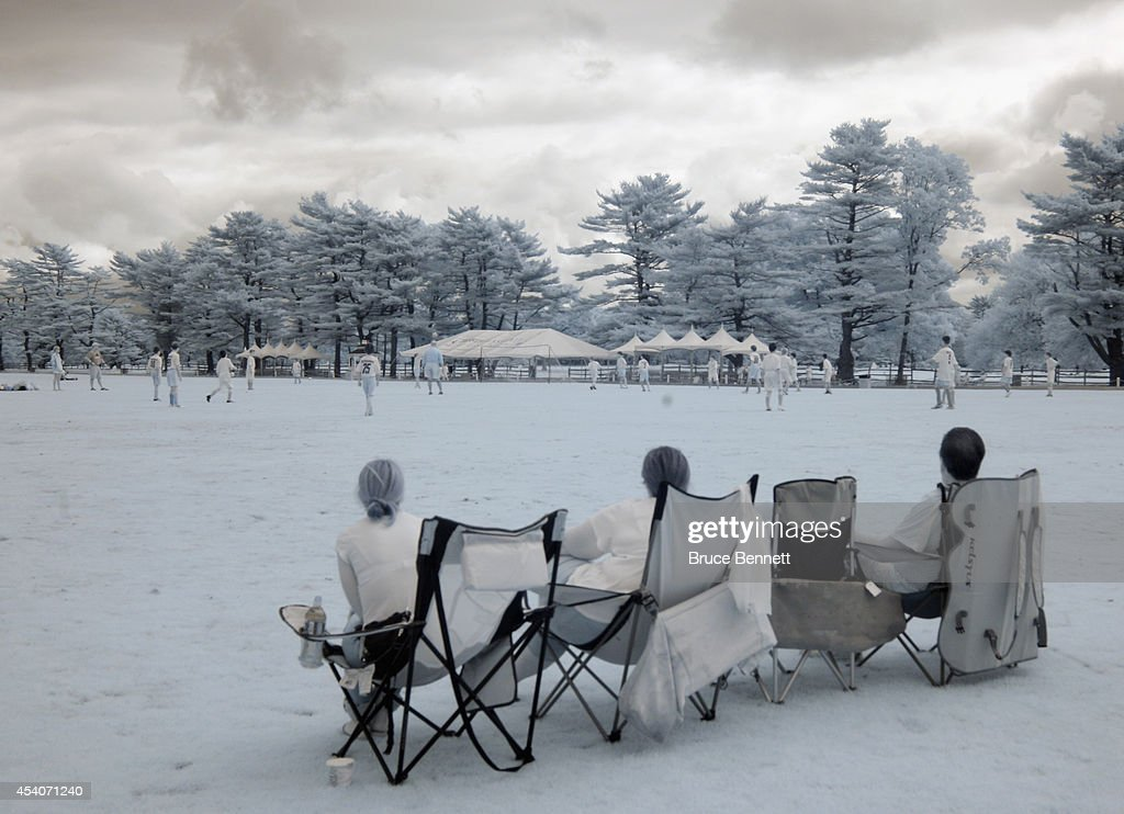 Onlookers watch a youth soccer game at Bethpage State Park on August 23, 2014 in Bethpage, New York.