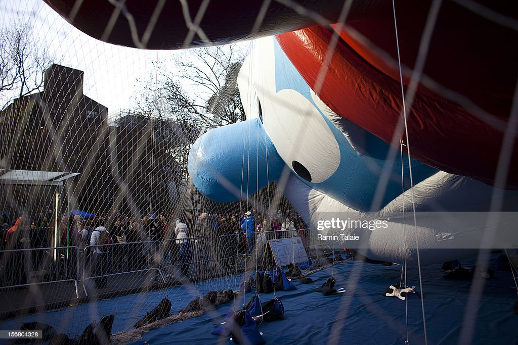 Onlookers watch as Macy's Thanksgiving Day Parade staff inflate a Smurf balloon in Manhattan's Upper West Side on November 21, 2012 in New York City. The 86th annual event is the second oldest Thanksgiving Day parade in the U.S.