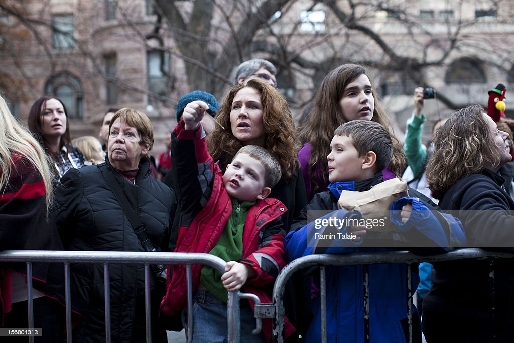 Onlookers watch as Macy's Thanksgiving Day Parade staff inflate balloons in Manhattan's Upper West Side on November 21, 2012 in New York City. The 86th annual event is the second oldest Thanksgiving Day parade in the U.S.