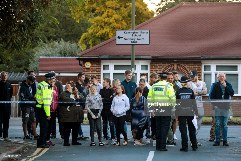 Onlookers watch as police conduct a raid on a property on Cavendish Road in connection with the terror attack at Parsons Green station on September 16, 2017 in Sunbury, England. An 18-year-old man has been arrested in Dover in connection with yesterday's terror attack on Parsons Green station in which 30 people were injured. The UK terror threat level has been raised to 'critical'.