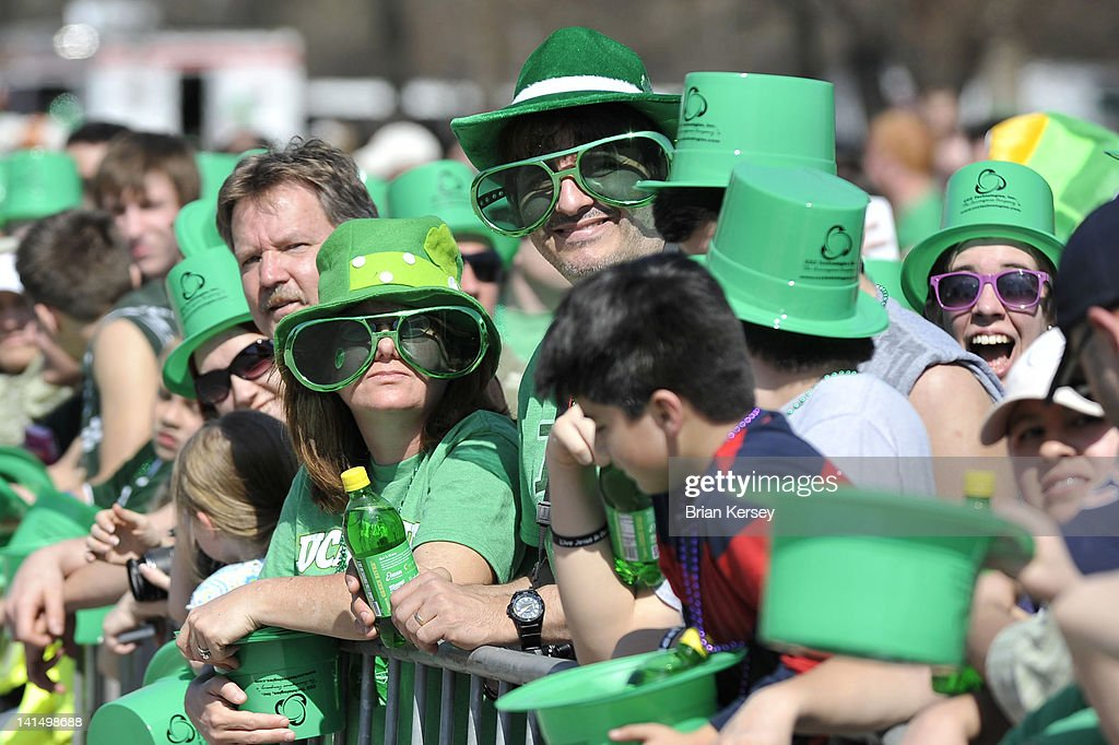 Onlookers watch the St Patrick's Day parade on March 17 2012 in Chicago Illinois Tens of thousands took advantage of record high temperatures and...