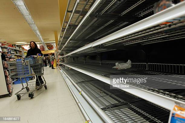 Only a few bread items remain on the shelves at the Waldbaums grocery store as Hurricane Sandy approaches on October 28 2012 in Long Beach New York...