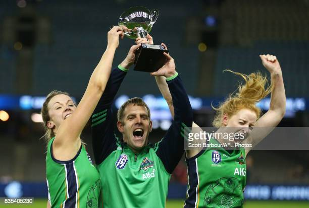 Onra Mulcahy captain of Ireland and the coach celebrate with the trophy after winning the 2017 International Cup Women's Grand Final match between...