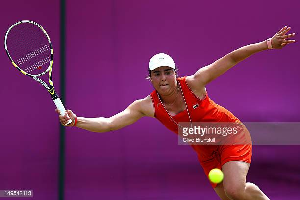 Ons Jabeur of Tunisia competes during her Women's Singles Tennis second round match against Sabine Lisicki of Germany on Day 3 of the London 2012...