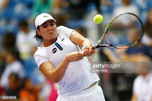 Ons Jabeur of Tunisia in action against Caroline Garcia of France in a round robin match during the WTA Rising Stars Invitational at OCBC Arena on...
