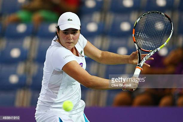 Ons Jabeur of Tunisia in action against Naomi Osaka of Japan in a round robin match during the WTA Rising Stars Invitational at OCBC Arena on October...