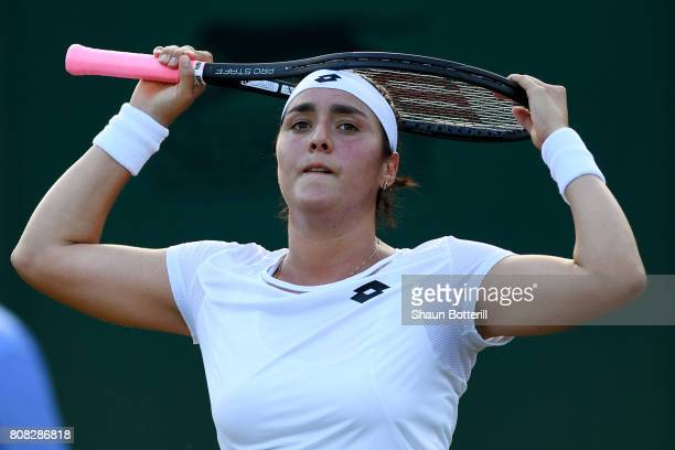 Ons Jabeur of Tunisia reacts during the Ladies Singles first round match against Svetlana Kuznetsova of Russia on day two of the Wimbledon Lawn...