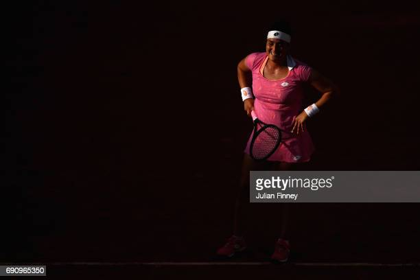 Ons Jabeur of Tunisia reacts during the ladies singles second round match against Dominika Cibulkoba of Slovakia on day four of the 2017 French Open...