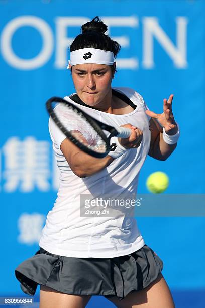 Ons Jabeur of Tunisia returns a shot during the match against Nina Stojanovic of Serbia during Day 4 of 2017 WTA Shenzhen Open at Longgang...